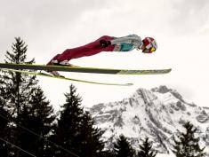 Poland's Kamil Stoch soars through the air to take the 13th place  in the FIS World Cup competition on December 16, 2012 in Engelberg, central Switzerland. AFP PHOTO / FABRICE COFFRINI        (Photo credit should read FABRICE COFFRINI/AFP/Getty Images)
