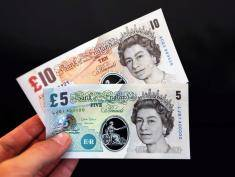 "LONDON, UNITED KINGDOM - SEPTEMBER 10:  In this photo illustration, sample Polymer five and ten pound British banknotes are held during a news conference at the Bank of England on September 10, 2013 in London, England.  Bank of England Deputy Governor Charlie Bean, said: ""Polymer banknotes are cleaner, more secure and more durable than paper notes. However, the Bank of England would print notes on polymer only if we were persuaded that the public would continue to have confidence in, and be comfortable with our notes. (Photo Illustration by Chris Ratcliffe-Pool/Getty Images)"