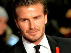 Former Manchester United and England footballer David Beckham poses for pictures as he arrives at the world premiere of the documentary 'The Class of 92', in London's Leicester Square, on December 1, 2013. AFP PHOTO / LEON NEAL        (Photo credit should read LEON NEAL/AFP/Getty Images)