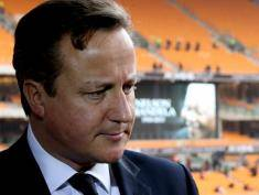 JOHANNESBURG, SOUTH AFRICA - DECEMBER 10:  British Prime Minister David Cameron speaks to the media as he attends the Nelson Mandela memorial service at the FNB Stadium, on December 10, 2013 in Johannesburg, South Africa. Over 60 heads of state have travelled to South Africa to attend a week of events commemorating the life of former South African President Nelson Mandela. Mr Mandela passed away on the evening of December 5, 2013 at his home in Houghton at the age of 95. Mandela became South Africa's first black president in 1994 after spending 27 years in jail for his activism against apartheid in a racially-divided South Africa. (Photo by Christopher Furlong/Getty Images)