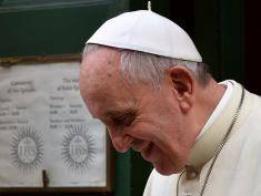 Pope Francis smiles as he leaves the Chiesa Del Gesu' (Jesuits' Church of Jesus) in Rome after celebrating a mass dedicated to French father Pierre Favre (1506-1546), on January 3, 2014. The pope's favorite Jesuit model was declared saint last month. PHOTO / ALBERTO PIZZOLI        (Photo credit should read ALBERTO PIZZOLI/AFP/Getty Images)