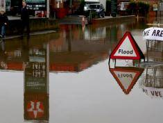 UPTON UPON SEVERN, UNITED KINGDOM - JANUARY 04:  A flood sign warns besides a petrol station close to the River Severn at Upton upon Severn is seen on January 4, 2014 in Worcestershire, England. After a period of recent storms and heavy rain, forecasters are warning that there is still more bad weather to come over the next few days.  (Photo by Matt Cardy/Getty Images)