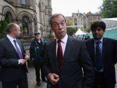 MANCHESTER, ENGLAND - SEPTEMBER 30:  Nigel Farage (C), the leader of the UK Independence Party, arrives to speak at a fringe event to the second day of the Conservative Party Conference in Manchester Town Hall on September 30, 2013 in Manchester, England. Chancellor of the Exchequer George Osborne has unveiled a Government plan for long-term unemployed people to undertake work placements in order to receive their benefits.  (Photo by Oli Scarff/Getty Images)