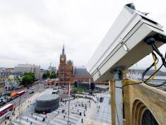 A CCTV security camera looks down towards King's Cross Square, the new public area outside the central London rail station on September 26, 2013.  AFP PHOTO/Leon Neal        (Photo credit should read LEON NEAL/AFP/Getty Images)
