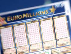 A person holds an Euromillions lottery ticket on november 14, 2012 in Nice. A lucky punter beat the French record for a Euromillions lottery today, winning a staggering 169,837,010 euros (almost $216 million), enough to buy nearly four tonnes of gold. The sole winner of the draw beats the former French record, won by a man in Calvados last year, by over seven million euros.   AFP PHOTO / VALERY HACHE        (Photo credit should read VALERY HACHE/AFP/Getty Images)
