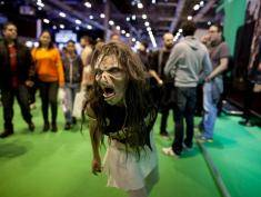 MADRID, SPAIN - NOVEMBER 09:  An actress dressed as a zombie performs at Madrid Games Week in IFEMA on November 9, 2013 in Madrid, Spain. Madrid's first edition of the Games Week runs from November 7-10, exhibiting products from some of the industry's leading software manufacturors. Spain now stands as the fourth largest European video gaming market and the sixth worldwide.  (Photo by Pablo Blazquez Dominguez/Getty Images)