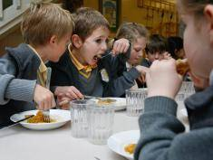 LONDON, UNITED KINGDOM - SEPTEMBER 30: Pupils at Putney Park School sit down for their lunch on September 30, 2008 in London, England. (Photo by Cate Gillon/Getty Images)