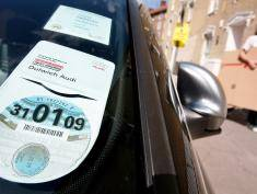 A 2008/ 2009 car tax disc is on display in a car windscreen on August 4, 2008 in London, England. Some MPs believe plans for new increased car tax rates on high fuel consumption vehicles should be made bolder to ensure a more effective impact on the environment.