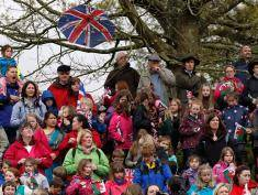 Members of the public wait to see Britain's Queen Elizabeth during  a visit to the Diamonds In The Park festival at Glanusk Park near Crickhowell.