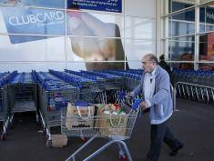 A man shops at a Tesco supermarket in Sunbury, west of London on April 22, 2015. Britain's biggest retailer, supermarket group Tesco, announced Wednesday that it had plunged massively into the red last year as it took a hit on the value of its property. AFP PHOTO / ADRIAN DENNIS        (Photo credit should read ADRIAN DENNIS/AFP/Getty Images)
