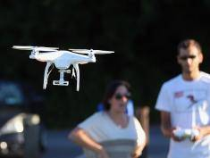 A drone is flown for recreational purposes in the sky above Syosset, New York on August 30, 2015.
