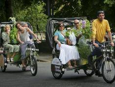 LONDON - MAY 28:  Garden enthusiasts catch rickshaws to transport their purchases during the last day of the Royal Horticultural Society's Chelsea Flower Show on May 28, 2005 in London, England. (Photo by Daniel Berehulak/Getty Images)