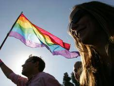 JERUSALEM, ISRAEL - NOVEMBER 10:  An Israeli homosexual dances with a rainbow flag at a Gay Pride rally November 10, 2006 in Jerusalem. About 2,000 alternative lifestyle Israelis were in attendance after ultra-Orthodox Jewish leaders compromised on the rally following a week of violent protests with the police over the planned Gay Pride parade through the streets of Jerusalem.  (Photo by David Silverman/Getty Images)