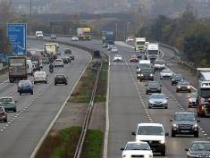 TAUNTON, ENGLAND - NOVEMBER 07:  Traffic flows on the reopened M5 motorway and pass the scene of a multiple fatal collision near Junction 25 on the M5 motorway on November 7, 2011 in Taunton, England. The investigation into Britain's worst motorway accident for 20 years in which seven people died, is currently continuing with the police stating that black smoke, thought to have been caused by a fireworks display at the nearby rugby club, the most likely cause.  (Photo by Matt Cardy/Getty Images)