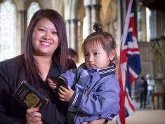 SALISBURY, ENGLAND - JUNE 09:  Durga Gurung and her son Shulabh, 2, pose for a photograph following a British citizenship ceremony in Salisbury Cathedral on June 9, 2015 in Salisbury, England. The citizenship ceremony was organised to celebrate multicultural Britain and was part of the Cathedral's Magna Carta 800th anniversary events programme.   (Photo by Matt Cardy/Getty Images)