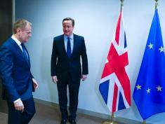 Britain's Prime Minister David Cameron (R) and European Council President Donald Tusk arrive to pose for a photo as they meet ahead of an EU summit meeting, at the European Union headquarters in Brussels, on February 18, 2016. EU leaders head into a make-or-break summit sharply divided over difficult compromises needed to avoid Britain becoming the first country to crash out of the bloc. / AFP / POOL / YVES HERMAN        (Photo credit should read YVES HERMAN/AFP/Getty Images)