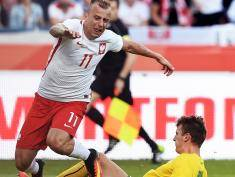 Poland's midfielder Kamil Grosicki (L) vies for the ball with Lithuania's Edvinas Girdvainis during the Euro 2016 friendly football match between Poland and Lithuania on June 6, 2016 in Krakow.   / AFP / JANEK SKARZYNSKI        (Photo credit should read JANEK SKARZYNSKI/AFP/Getty Images)