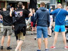 A small group of Russian men provoke a group of England supporters in the centre of Lille, on June 14, 2016, three days after Russia and England football fans clashed in the southern French city of Marseille during the Russia vs England, group B, Euro 2016 match.  / AFP / LEON NEAL        (Photo credit should read LEON NEAL/AFP/Getty Images)