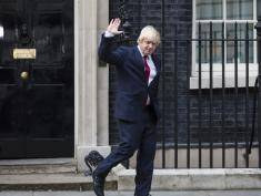 LONDON, ENGLAND - JULY 13: Boris Johnson waves as he leaves Downing Street after being appointed Foreign Secretary on July 13, 2016 in London, England. The UK's New Prime Minister Theresa May began appointing the key Ministerial positions in her cabinet shortly after taking up residence at Number 10 Downing Street. She has appointed Philip Hammond as Chancellor and George Osborne has resigned. (Photo by Jack Taylor/Getty Images)