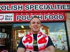 "CREWE, UNITED KINGDOM - APRIL 01:  Polish worker Dominik Wasilewski poses outisde the Dwa Koty Polish delicatessen where he works on 1 April, 2008, Crewe, England. Crewe in Cheshire has one of Britain's biggest communities of Poles in the UK and is continuing to thrive.  British Prime Minister Gordon Brown today dismissed suggestions that immigration into the United Kingdom should be capped and said that immigration is good for the country. Brown responded to a report by a House of Lords committee that record immigration had ""little or no"" impact on people's economic well-being.  (Photo by Christopher Furlong/Getty Images)"