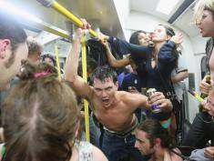 Party revellers enjoy the atmosphere on the London Underground at xxxx station during a Facebook cocktail party on the Circle Line on May 31, 2008 in central London, England. Tonight is the last evening when Londoners can consume alcohol on public transport. The cocktail party, organised on the networking Web site Facebook, attracted thousands of revellers to enjoy one last drink on the London Underground before the ban's enforcement on June 1, 2008. The ban, introduced by the new London Mayor Boris Johnson, is an attempt to clean up unruly behaviour on the London public transport system.
