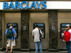 LONDON - JULY 29:  Commuters withdraw cash from ATM's outside a branch of Barclays Bank July 29, 2002 on Regent Street in London, England. Barclays will announce its semiannual financial results August 2. (Photo by Sion Touhig/Getty Images)