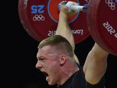 Poland's Tomasz Bernard Zielinski competes during the men's 94kg group B weightlifting event of the London 2012 Olympic Games at The Excel Centre in London on August 4, 2012. AFP PHOTO / YURI CORTEZ        (Photo credit should read YURI CORTEZ/AFP/GettyImages)