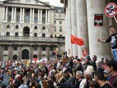 Protestors march through central London during a demonstration against austerity and spending cuts on June 20, 2015 in London, England. Thousands of people gathered to march from the City of London to Westminster, where they listened to addresses from singer Charlotte Church and comedian Russell Brand as well as Len McCluskey, general secretary of Unite and Sinn Fein's Martin McGuinness.