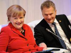 THE HAGUE, NETHERLANDS - MARCH 25:  German Chancellor Angela Merkel and and Finnish President Sauli Niinisto attend an informal plenary at the 2014 Nuclear Security Summit on March 25, 2014 in The Hague, Netherlands. Leaders from around the world have come to discuss matters related to international nuclear security, though the summit has been overshadowed by recent events in Ukraine.  (Photo by John Thys - Pool/Getty Images)