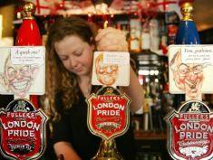 LONDON, UNITED KINGDOM:  A barmaid at the Old Bell in London pulls a pint of beer 22 April, 2005 from a tap with a picture of one of the three major candidates running in Britain's up coming general election. The taps all contain the same brand of beer, with patrons chosing either Labour's Tony Blair (L), Liberal Democrat's Charles Kennedy (C) or Conservative's Michael Howard and the pub keeping track of amount beer consumed as a straw poll. Currently, Blair is leading his rivals at the Old Bell.    AFP PHOTO/ODD ANDERSEN  (Photo credit should read ODD ANDERSEN/AFP/Getty Images)