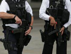 """Armed police personnel patrol near London's Trafalgar Square on August 4, 2016, following an overnight knife attack in Russell Square in which one woman was killed and five others injured. A 19-year-old man detained by police at the scene of a stabbing spree in London has been arrested on suspicion of murder, police said Thursday. """"We continue to focus our lines of inquiry on mental health while retaining an open mind regarding the motive,"""" London police said in a statement.   / AFP / DANIEL LEAL-OLIVAS        (Photo credit should read DANIEL LEAL-OLIVAS/AFP/Getty Images)"""
