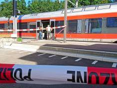 """Policemen stand by a train at the station in Salez, eastern Switzerland, after a man set a fire and stabbed passengers on August 13, 2016. A man set a train carriage in Switzerland on fire using a flammable liquid and stabbed passengers, injuring six people including a six-year-old child, police said. / AFP / newspictures.ch / Beat KAELIN / Switzerland OUT / MANDATORY MENTION OF THE CREDIT """"AFP PHOTO/NEWSPICTURES.CH/BEAT KAELIN""""        (Photo credit should read BEAT KAELIN/AFP/Getty Images)"""