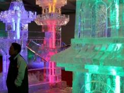 """BERLIN - NOVEMBER 26:   A man walks among Chinese ice sculptures during the media day at the """"Ice Art"""" exhibition next to the O2 Arena on November 26, 2009 in Berlin, Germany. The exhibition will be open to the public from November 27 until February 22.  (Photo by Sean Gallup/Getty Images)"""