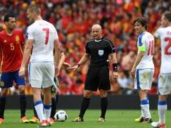 Polish referee Szymon Marciniak (C) gestures during the Euro 2016 group D football match between Spain and Czech Republic at the Stadium Municipal in Toulouse on June 13, 2016. / AFP / PASCAL GUYOT        (Photo credit should read PASCAL GUYOT/AFP/Getty Images)