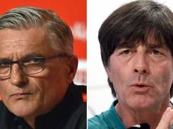 A combination of two file pictures shows Poland's coach Adam Nawalka in La Baule on June 7, 2016, and Germany's coach Joachim Loew in Evian-les-Bains on June 8, 2016. Germany will face Poland in their Euro 2016 Group C football match in Paris on June 16 , 2016. / AFP / LOIC VENANCE AND Patrik STOLLARZ        (Photo credit should read LOIC VENANCE,PATRIK STOLLARZ/AFP/Getty Images)