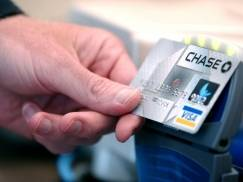 DENVER-JUNE 8: Chase Bank announces new credit card technologies. Demostrating at a local Arby's in Denver , Colorado the credit card never leaves the user the card is held a few inches from a terminal at the counter and scanned reading a small chip inside the card. (Photo by Thomas Cooper/Getty Images)