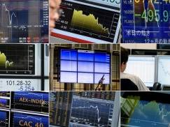 A combination made on June 24, 2016 shows monitors displaying exchange rates in Paris, Tokyo, Sydney and Amsterdam.  Britain has voted to break out of the European Union, striking a thunderous blow against the bloc and spreading panic through world markets on June 24 as sterling collapsed to a 31-year low. / AFP / -        (Photo credit should read -/AFP/Getty Images)