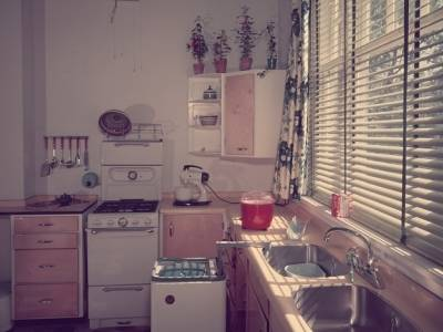 circa 1955:  A fully fitted kitchen, complete with stove, washing machine, double sink unit and electric mixer.  (Photo by Chaloner Woods/Getty Images)